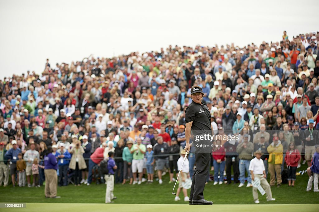 Phil Mickelson watching his putt on No 18 green during Sunday play at TPC Scottsdale. Kohjiro Kinno F606 )