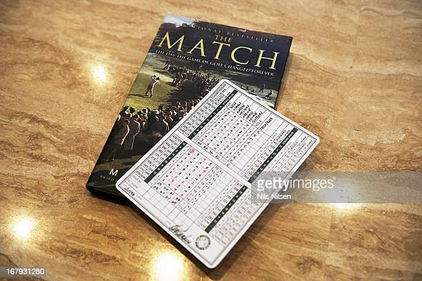 World Golf Hall of Fame View of scorecard from The Match during memorabilia selection for HOF induction of Ken Venturi at his home View of Mark Frost...