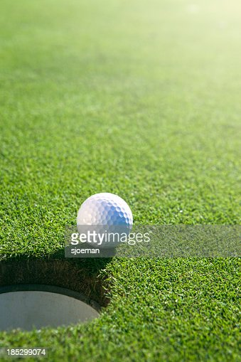 Golfball close to hole