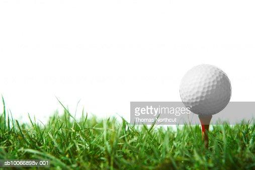 Golfball sur le tee-shirt : Photo
