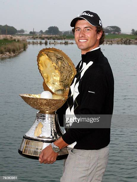Golfer Adam Scott of Australia poses with his trophy after winning the Qatar Masters Golf Tournament in Doha 27 January 2008 Scott stormed to an...