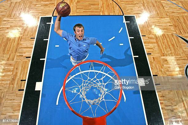 Golfer Aerial portrait of PGA rookie Dustin Johnson dunking basketball at Amway Arena Orlando FL 3/12/2008