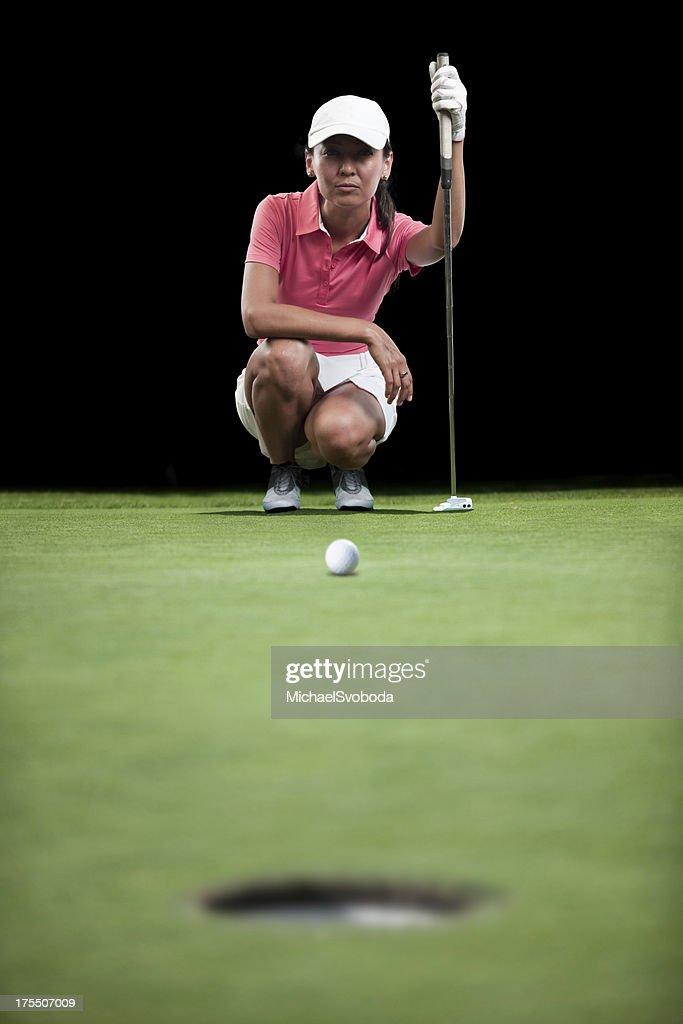 Golfer Aiming Her Putt