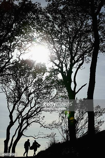 A golfer and a caddy make their way to the 12th tee during the first round of the 2014 Alfred Dunhill Links Championship at the Kingsbarns Golf Links...