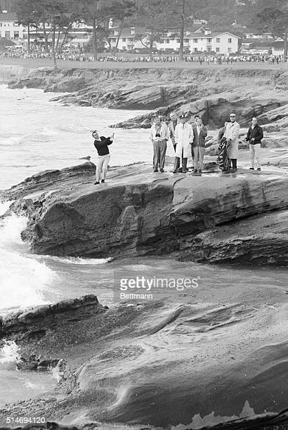 Golfer Arnold Palmer chips for the 17th green from the rocky coast along the Pebble Beach golf course during the Bing Crosby ProAm Golf Tournament...