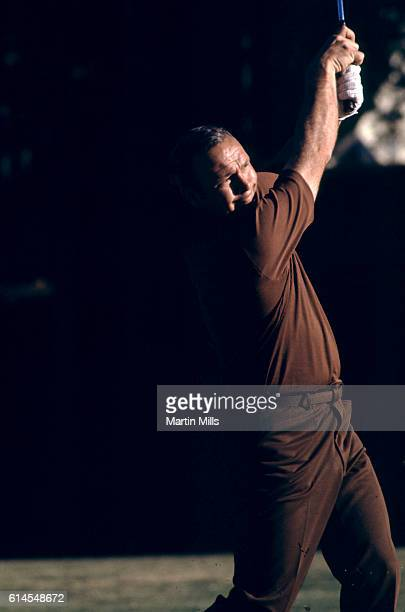 Golfer Arnold Palmer of the USA swings during a golf event circa 1975