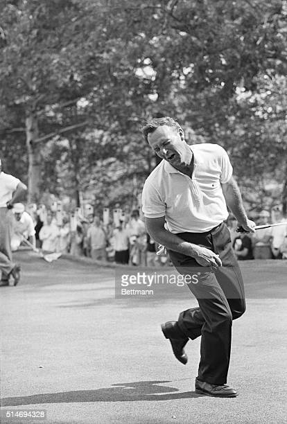 Golfer Arnold Palmer shows his displeasure with missing a putt on the 8th hole at the US Open golf tournament in Brookline Massachusetts June 23 1963