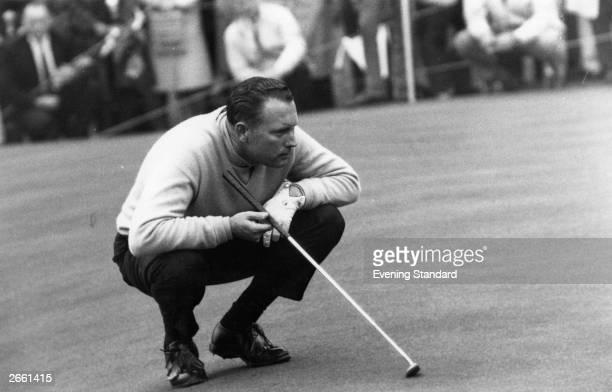 Golfer Billy Casper who won the 1966 US Open lining up a put