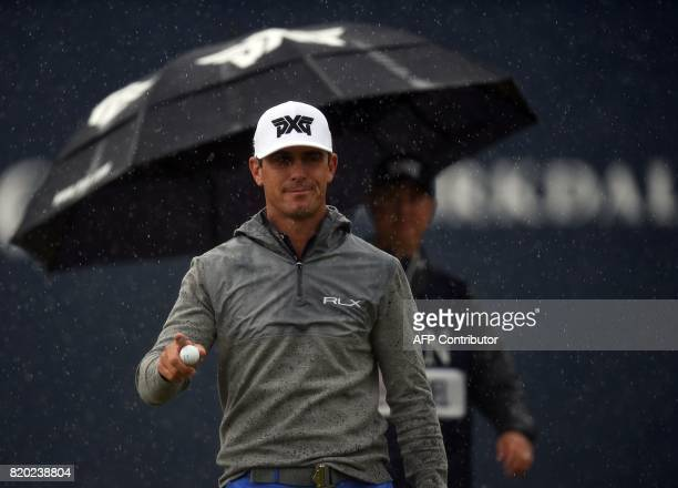 US golfer Billy Horschel smiles in the rain as he finishes his round on the 18th green on day two of the Open Golf Championship at Royal Birkdale...