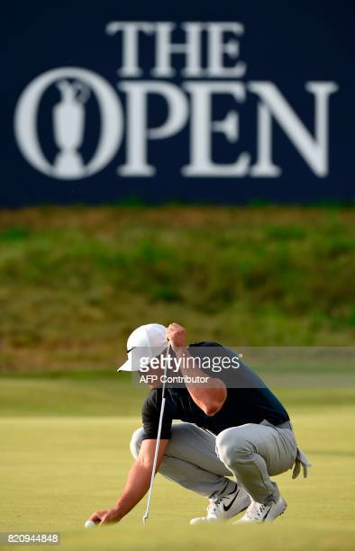 US golfer Brooks Koepka lines up a putt on the 18th green during his third round on day three of the Open Golf Championship at Royal Birkdale golf...