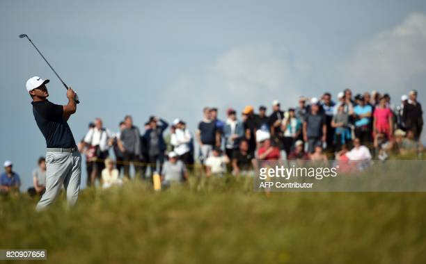US golfer Brooks Koepka plays an approach shot during his third round on day three of the Open Golf Championship at Royal Birkdale golf course near...
