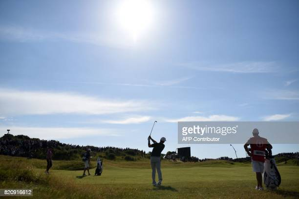 US golfer Brooks Koepka plays from the 10th fairway during his third round on day three of the Open Golf Championship at Royal Birkdale golf course...