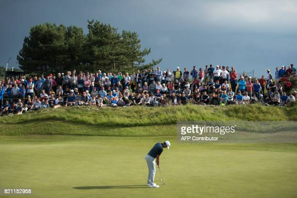 US golfer Brooks Koepka putts on the 11th green during his third round on day three of the Open Golf Championship at Royal Birkdale golf course near...