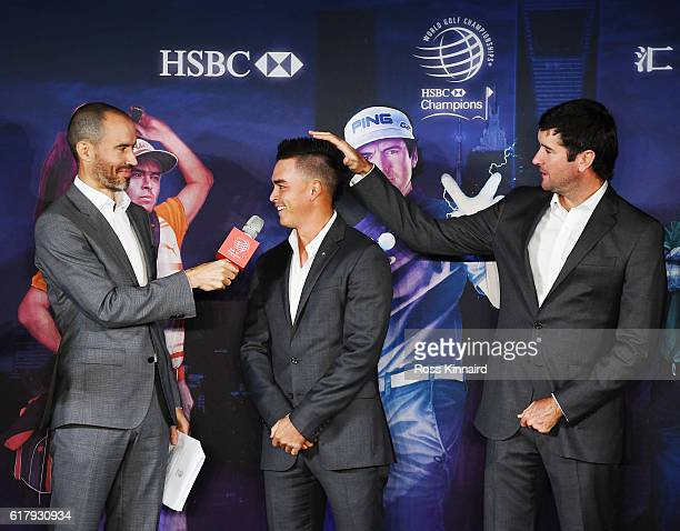 Golfer Bubba Watson clowns around with Rickie Fowler on stage at the Himalayas Centre as Andrew Cotter looks on prior to the start of the WGC HSBC...