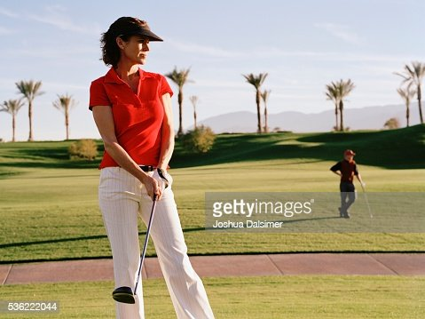 Golfer carrying golf club : Stock Photo