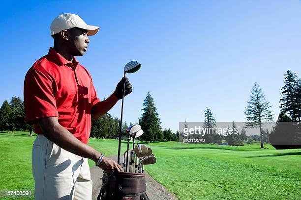 Golfista escolher clube