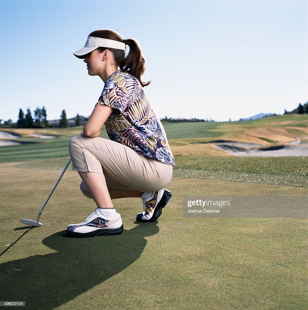 Golfer crouching : Stock Photo