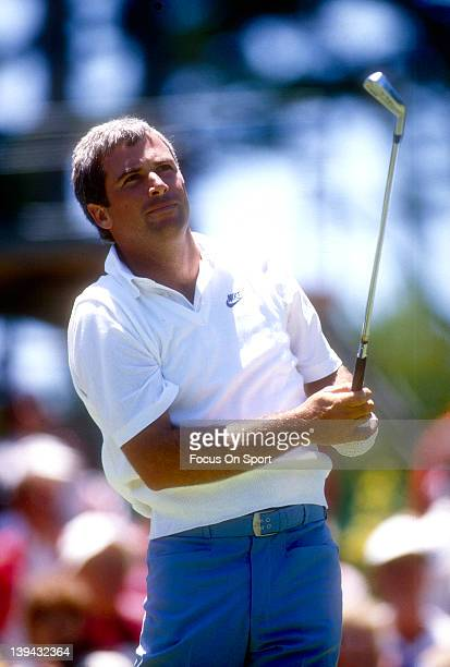 Golfer Curtis Strange swings and watches the flight of his ball during the US Open June 1987 at the Olympic Club in San Francisco California