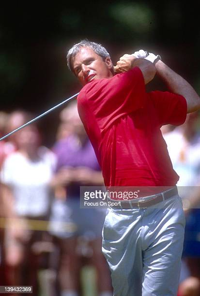 Golfer Curtis Strange swings and watches the flight of his ball during the US Open in June 1990 at The Medinah Country Club in Medinah Illinois
