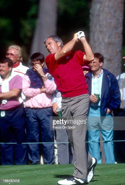 Golfer Curtis Strange swings and watches the flight of his ball during the Masters in April 1990 at Augusta National in Augusta Georgia