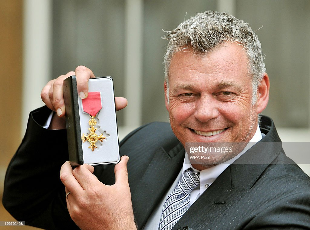 Golfer Darren Clarke holds his OBE, for services to golf, which was awarded to him by Queen Elizabeth II during an Investiture ceremony at Buckingham Palace on November 21, 2012 in London, England.
