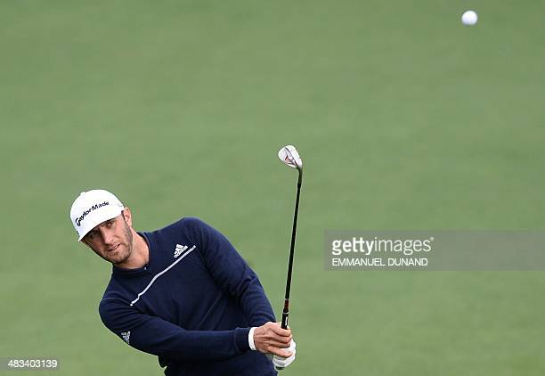US golfer Dustin Johnson chips onto a green during a practice round for the Masters Tournament at Augusta National Golf Club Augusta Georgia April 8...