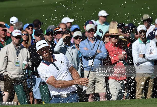US golfer Dustin Johnson hits out of a bunker on the 2nd hole during Round 1 of the 80th Masters Golf Tournament at the Augusta National Golf Club on...