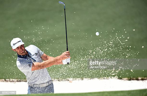 US golfer Dustin Johnson hits out of a bunker on the 2nd hole during Round 3 of the 80th Masters Golf Tournament at the Augusta National Golf Club on...