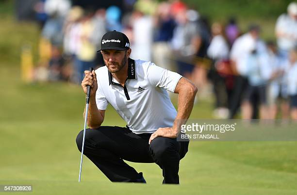 US golfer Dustin Johnson lines up a his putt on the 12th Green during his first round on the opening day of the 2016 British Open Golf Championship...