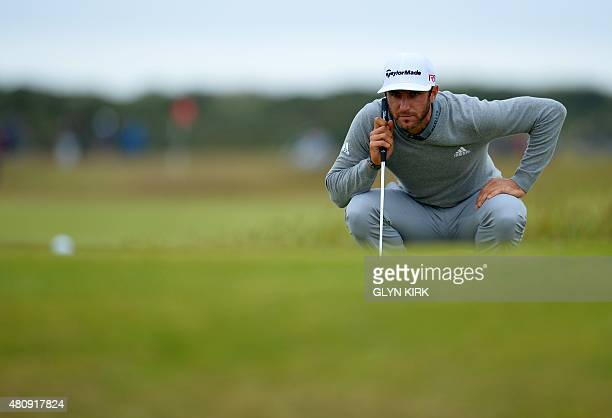 US golfer Dustin Johnson lines up his putt on the 11th green during his first round 65 on the opening day of the 2015 British Open Golf Championship...