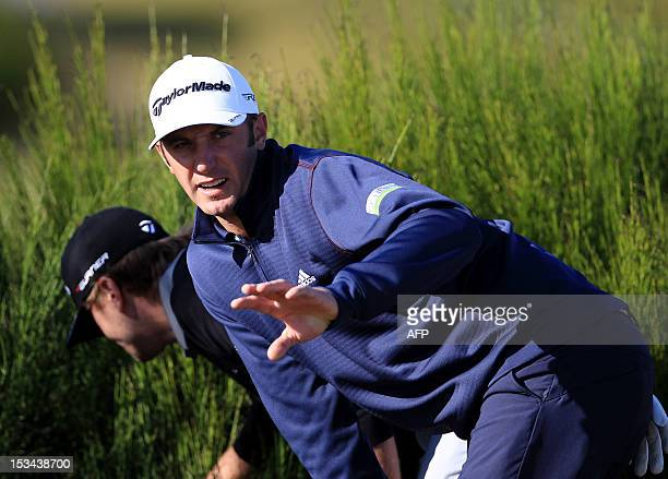 US golfer Dustin Johnson looks for his brother Austins lost ball during day two of the Alfred Dunhill Links Championship at Kings Barns Scotland on...