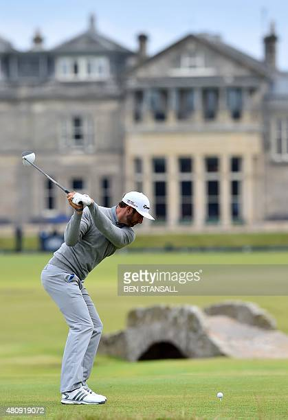 US golfer Dustin Johnson plays from the 18th tee during his first round 65 on the opening day of the 2015 British Open Golf Championship on The Old...