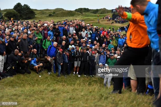 US golfer Dustin Johnson plays from the rough on the 8th hole during his second round on day two of the Open Golf Championship at Royal Birkdale golf...