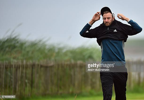 US golfer Dustin Johnson puts on his top on the 2nd tee during his third round on day three of the 2016 British Open Golf Championship at Royal Troon...