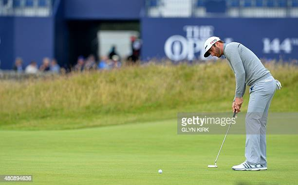 US golfer Dustin Johnson putts during his first round on the opening day of the 2015 British Open Golf Championship on The Old Course at St Andrews...