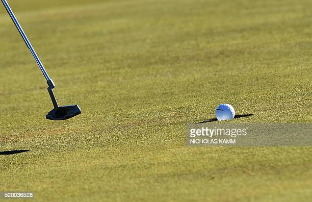 TOPSHOT US golfer Dustin Johnson putts on the 18th green during Round 3 of the 80th Masters Golf Tournament at the Augusta National Golf Club on...