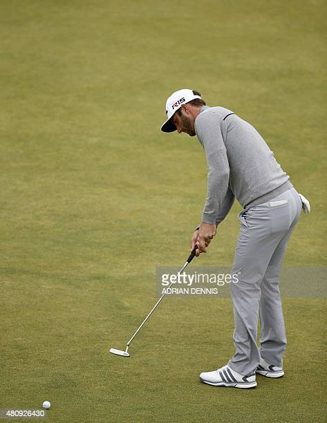 US golfer Dustin Johnson putts on the 6th green during his first round 65 on the opening day of the 2015 British Open Golf Championship on The Old...