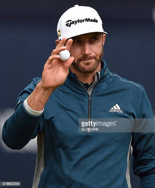 US golfer Dustin Johnson reacts on the 18th green after his third round 72 on day three of the 2016 British Open Golf Championship at Royal Troon in...
