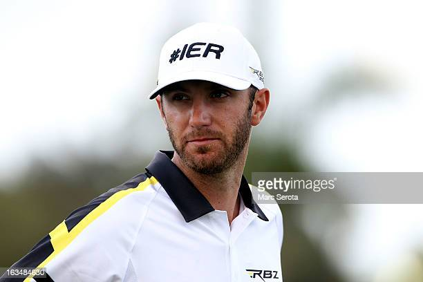 Golfer Dustin Johnson reacts on the 18th hole at the World Golf ChampionshipsCadillac Championship at the Trump Doral Golf Resort Spa on March 10...