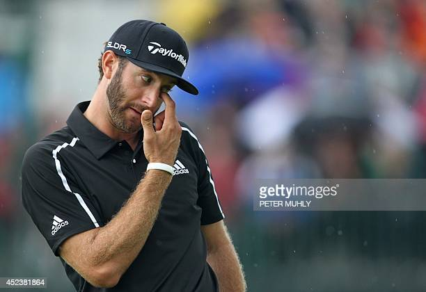 US golfer Dustin Johnson reacts to a missed putt on the 8th green during his third round 71 on day three of the 2014 British Open Golf Championship...