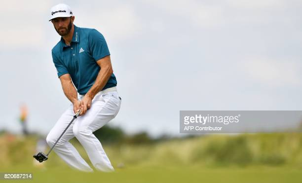 US golfer Dustin Johnson reacts to missing a putt on the 9th green during his third round on day three of the Open Golf Championship at Royal...