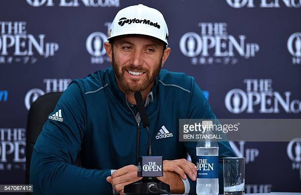 US golfer Dustin Johnson smiles as he speaks to members of the media at a press conference on July 13 ahead of the 2016 British Open Golf...
