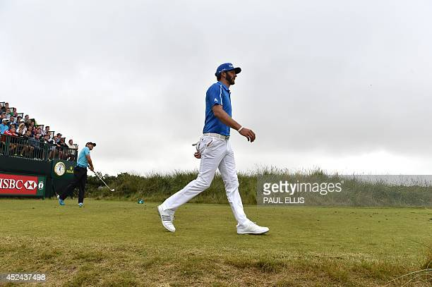 US golfer Dustin Johnson walks from the 13th gtee during his fourth round on the final day of the 2014 British Open Golf Championship at Royal...