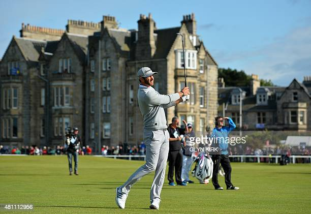 US golfer Dustin Johnson watches his approach shot from the 1st fairway during his second round on day two of the 2015 British Open Golf Championship...