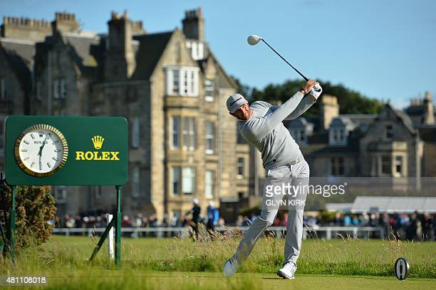 US golfer Dustin Johnson watches his drive from the 2nd tee during his second round on day two of the 2015 British Open Golf Championship on The Old...
