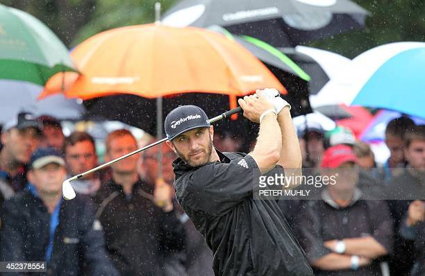 US golfer Dustin Johnson watches his shot from the 5th tee during his third round on day three of the 2014 British Open Golf Championship at Royal...