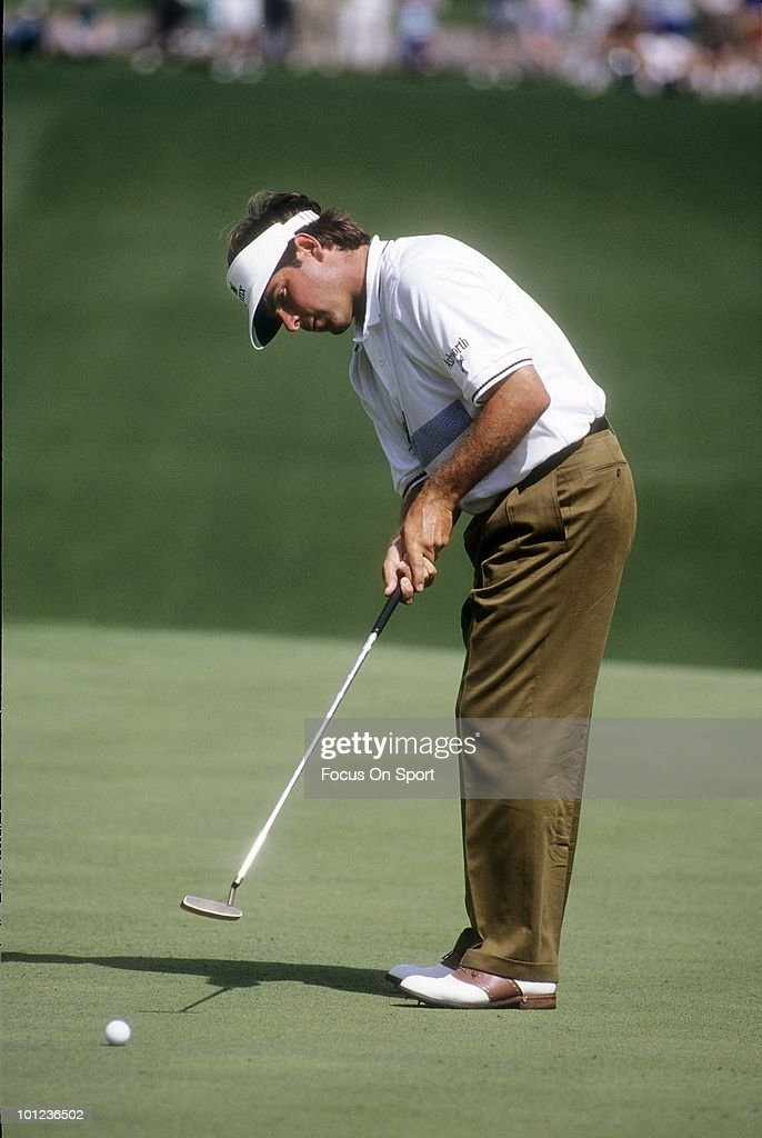 Golfer Fred Couples in action putting during play April 12, 1992 at the Masters at Augusta National Golf Club in Augusta, Georgia. Couples won the tournament at -13 under par.