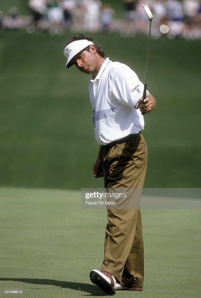 Golfer Fred Couples in action watches his putt during play April 12, 1992 at the Masters at Augusta National Golf Club in Augusta, Georgia. Couples won the tournament at -13 under par.