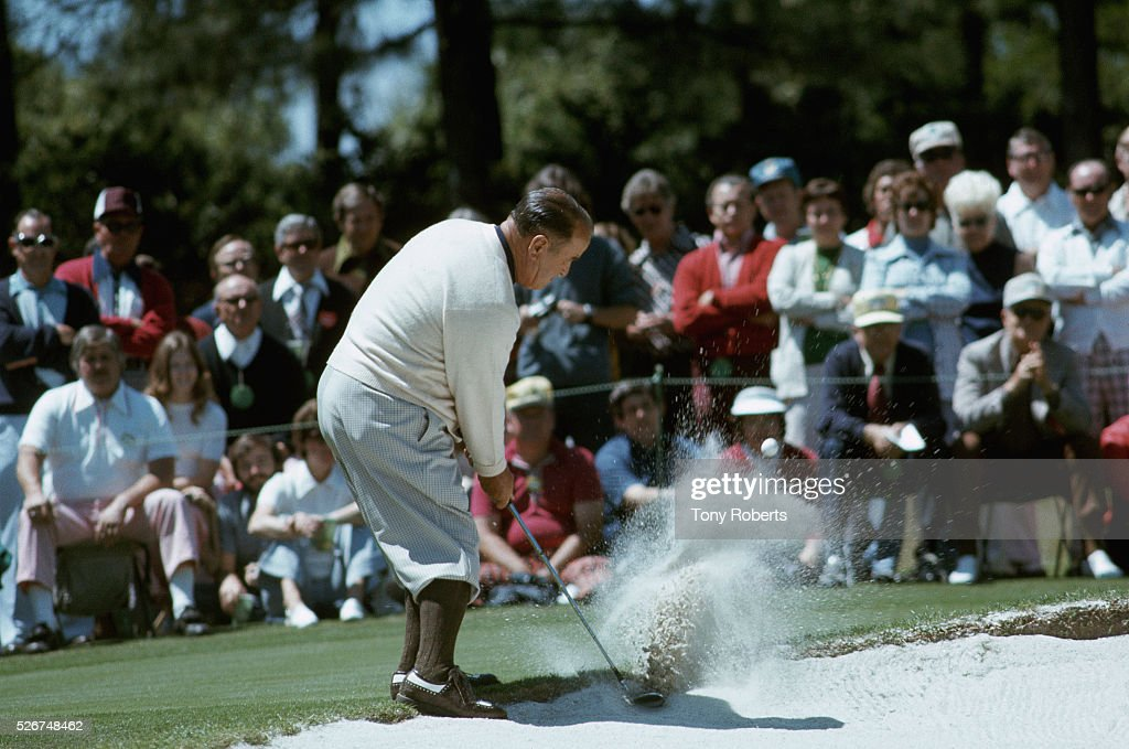 PGA golfer <a gi-track='captionPersonalityLinkClicked' href=/galleries/search?phrase=Gene+Sarazen&family=editorial&specificpeople=890883 ng-click='$event.stopPropagation()'>Gene Sarazen</a> hits out of a sand trap at the 1974 Masters Tournament.
