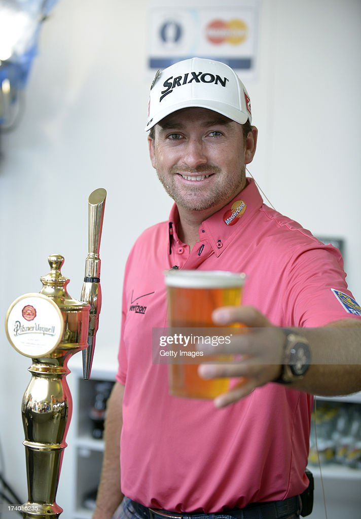 Golfer <a gi-track='captionPersonalityLinkClicked' href=/galleries/search?phrase=Graeme+McDowell+-+Golfer&family=editorial&specificpeople=196520 ng-click='$event.stopPropagation()'>Graeme McDowell</a> pours a priceless pint at the MasterCard Club after the second round of the 142nd Open Championship at Muirfield on July 19, 2013 in Gullane, Scotland.